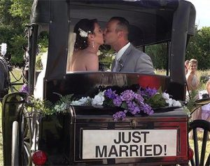 Just Married in Horse Drawn Carraige